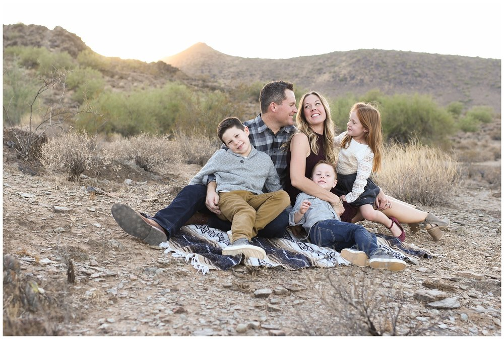Family on a blanket in the desert in Phoenix | Lifestyle Family Photography in Phoenix