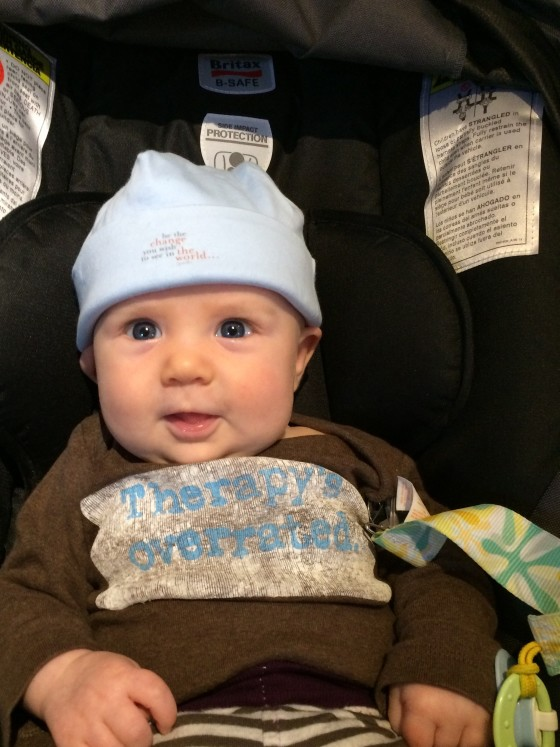 Gandhi hat quote accompanied by the best onesie for a therapist parent all on a happy baby!