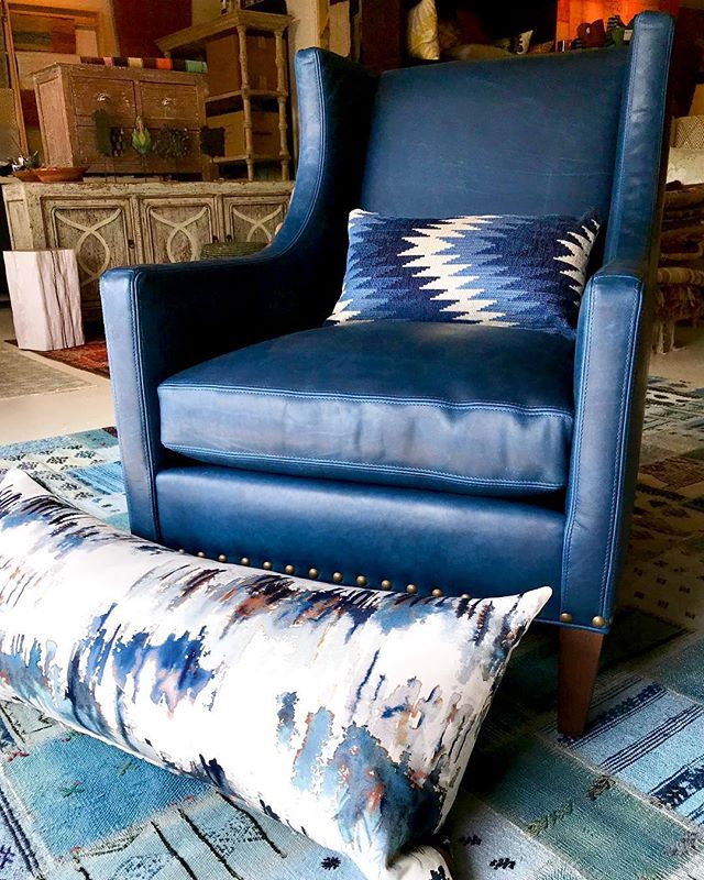 Meanwhile, back at the studio today, a calming blue water leather club chair arrives for a clients living room. Our workroom churned out this painterly fabric bolster pillow for a bedroom install and a vintage kilim rug awaits a causal family room. #timothypaulcarpets #timothypaulinteriordesign #romo@romo#leeindustries #blueinteriors #indigodesign #beachinteriors #costaliving #bluerooms