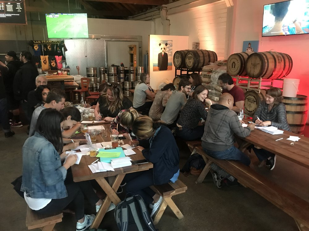 Writing postcards at IndivisibleSF Ale and Mail Happy Hour (photo)