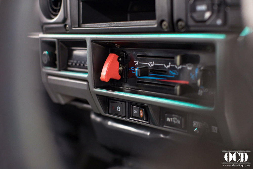 The Toyota Landcruisers rugged interior - Electric Winch & in-out Switch.