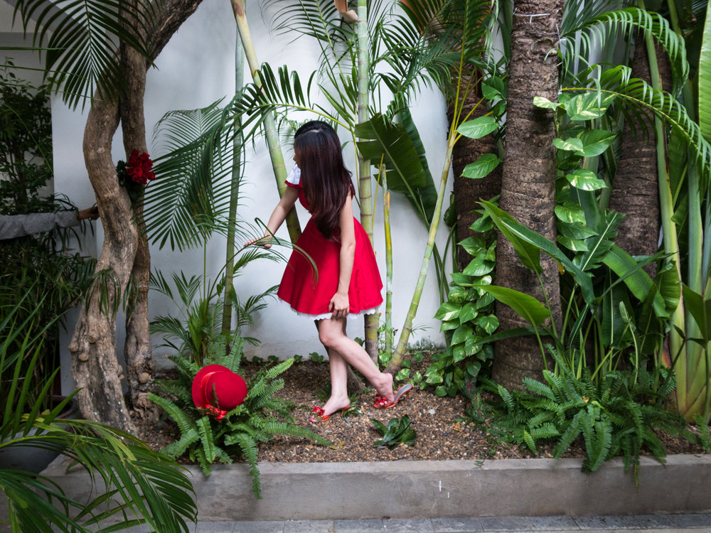 Feb 10, 2012 - Phnom Penh, Cambodia. A model poses for a fashion shoot in a boutique hotel. In 2009, fashion became a trendy investment in Cambodia, with high-end labels starting to become available in the capital. In 2011, Cambodia hosted its first annual fashion week. © Nicolas Axelrod / Ruom