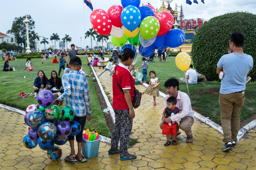 May 28, 2016 - Phnom Penh, Cambodia. Families gather on the lawns out side the Royal Palace. The Royal family in Cambodia is still very much present but holds an honorary roll in the country. © Nicolas Axelrod / Ruom