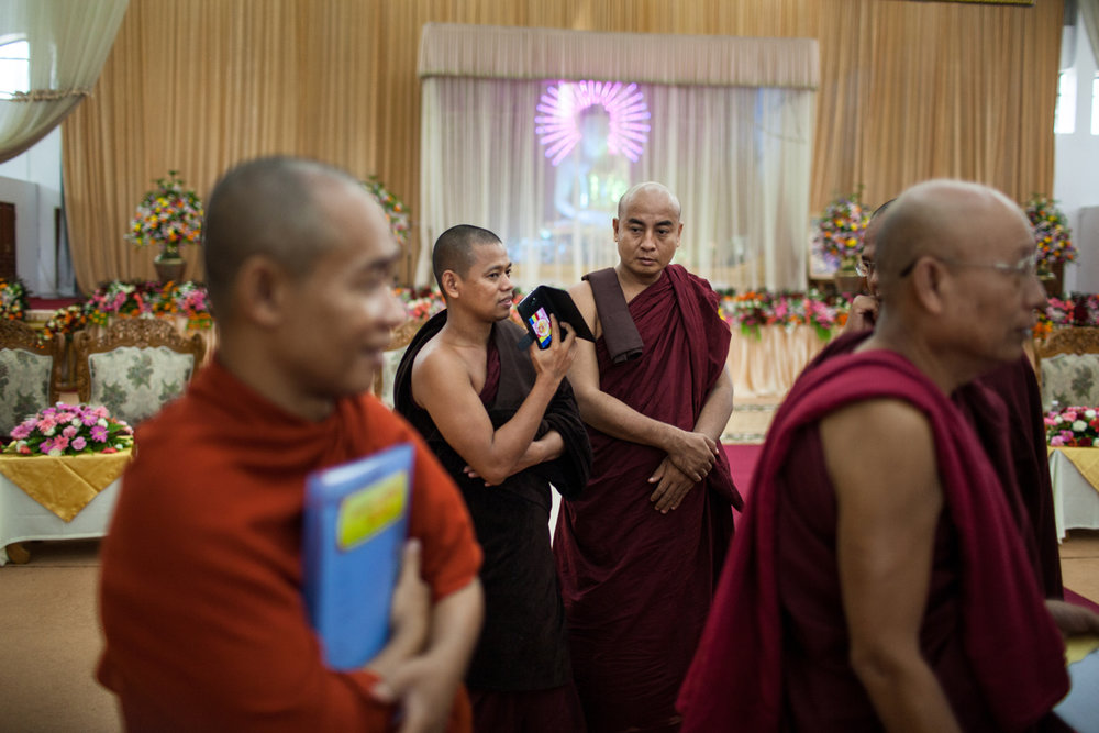 June 14, 2013 - Yangon, Myanmar. Monks, including members of the 969 movement (later called Ma Ba Tha) gather to discuss the passing of four laws known collectively as the 'Race and Religion Protection Laws'. The Monogamy Law, were legislation makes it a criminal offence to have more than one spouse or to live with an unmarried partner who is not a spouse. The Religious Conversion Law requires that a Myanmar citizen who wishes to change his/her religion must obtain approval from a newly established Registration Board for religious conversion, set up in townships. The Interfaith Marriage Law regulates the marriages of Buddhist women to non-Buddhist men. Finally the Population Control Law imposes on women in certain regions the requirement to space the birth of their children 36 months apart. © Nicolas Axelrod / Ruom