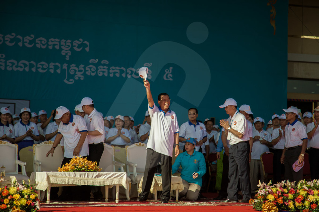 Cambodian Prime Minister Hun Sen cheers CPP (Cambodian People Party) supporters minutes ahead the beginning of the opening ceremony on Koh Pich island (Phnom Penh) on the first day of the 2013 Cambodian Legislative Election campaign. 27 June 2013 © Thomas Cristofoletti / RUOM 2013