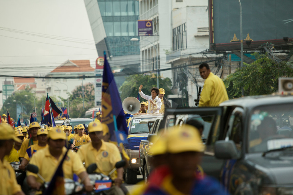 Princess Norodom Arunrasmey, daughter of late king Norodom Sihanouk and head of the royalist party, FUNCIPENC, cheers her supporters during a parade through the streets of Phnom Penh. 03 July 2013 © Thomas Cristofoletti / Ruom 2013