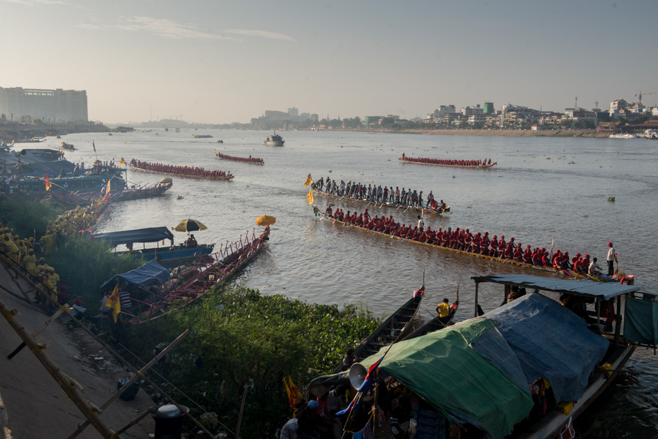 Racing boats move along the Tonle Sap for pre-race practice runs. Though the prize for winning boats is relatively small, sponsorships and private donations can make winning a profitable prospect. Cambodia's annual 3-day water festival celebrates the reversal of the flow of the Tonle Sap River - an event of large cultural significance because of the river's role in national fishing and agriculture. The event was cancelled for three previous years in a row after the stampede incident in 2010, when nearly 350 people were killed and roughly 750 more were injured.