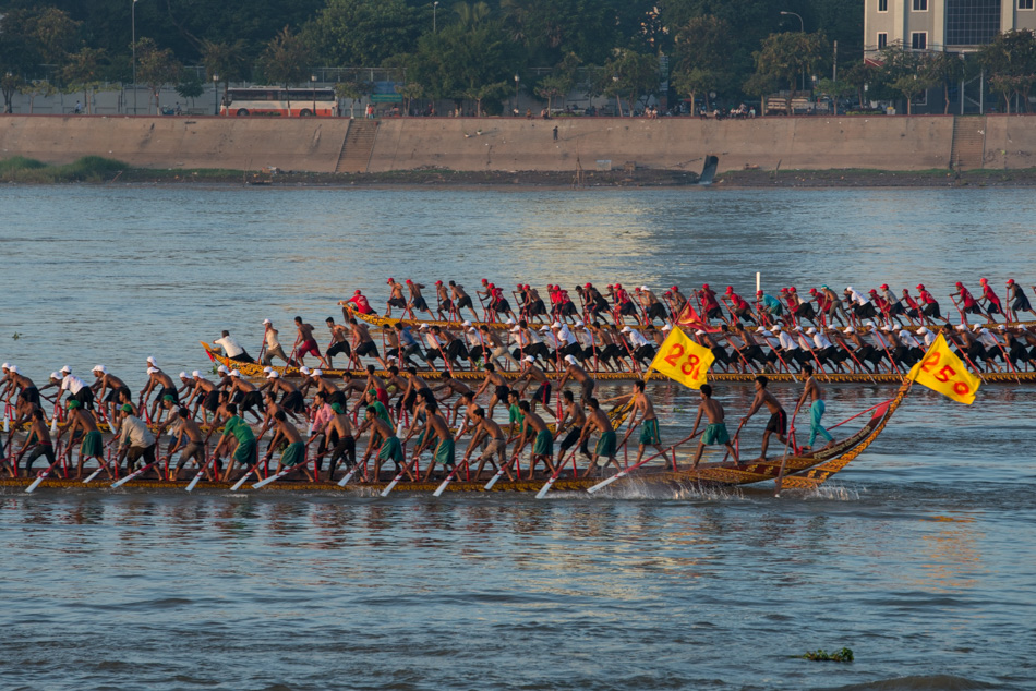 A racing boat coach encourages his teams before their race. Cambodia's annual 3-day water festival celebrates the reversal of the flow of the Tonle Sap River - an event of large cultural significance because of the river's role in national fishing and agriculture. The event was cancelled for three previous years in a row after the stampede incident in 2010, when nearly 350 people were killed and roughly 750 more were injured.