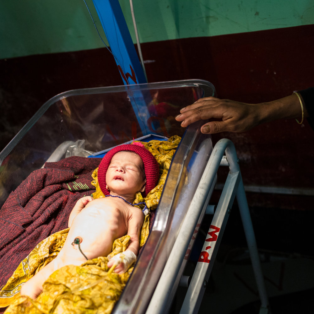 Nov. 30, 2014 - Thakurgon, Bangladesh. Runa Akther (18) attends to her baby at the Thakurgon district hospital. The hospital has the only neonatal care unit with in four districts. © Nicolas Axelrod / Ruom for UNFPA