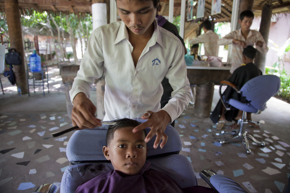 Hairdressing, vocational training. Kaliyan Mith education centre. The centre holds a pre-school, non-formal education, sports, library, vocational training for over 200 children. Siem Reap, Cambodia