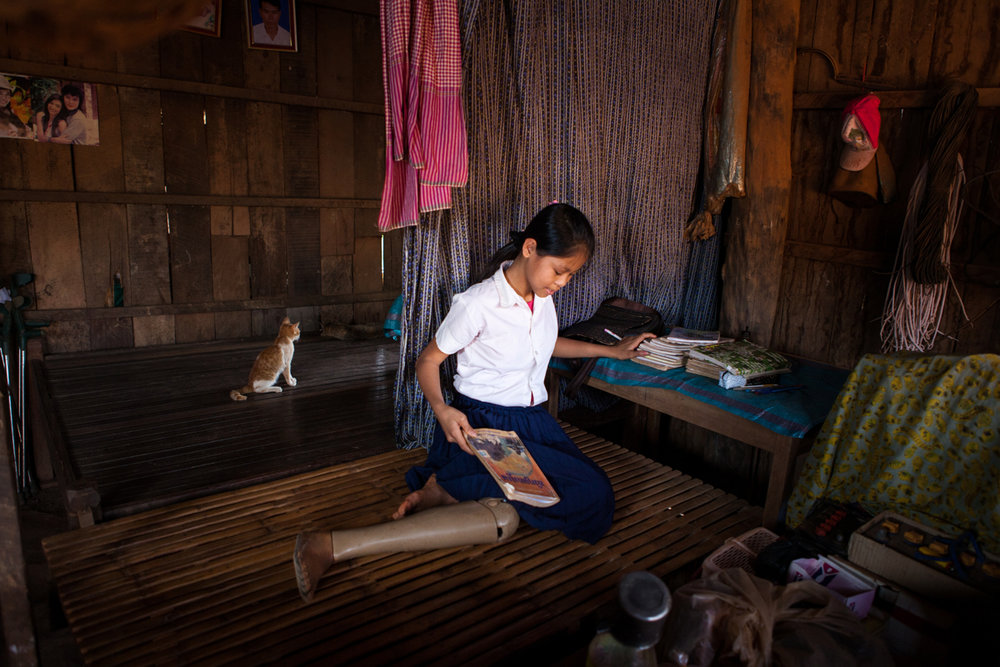 March 01, 2013 - Memot, Cambodia. Kanha Teng (16) in her home. � Nicolas Axelrod for HI