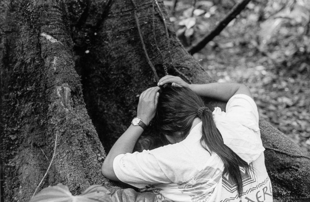 A Traditional Sápara Greeting to a Tree  — Gloria bows in reverence to the spirits of the forest, 1999