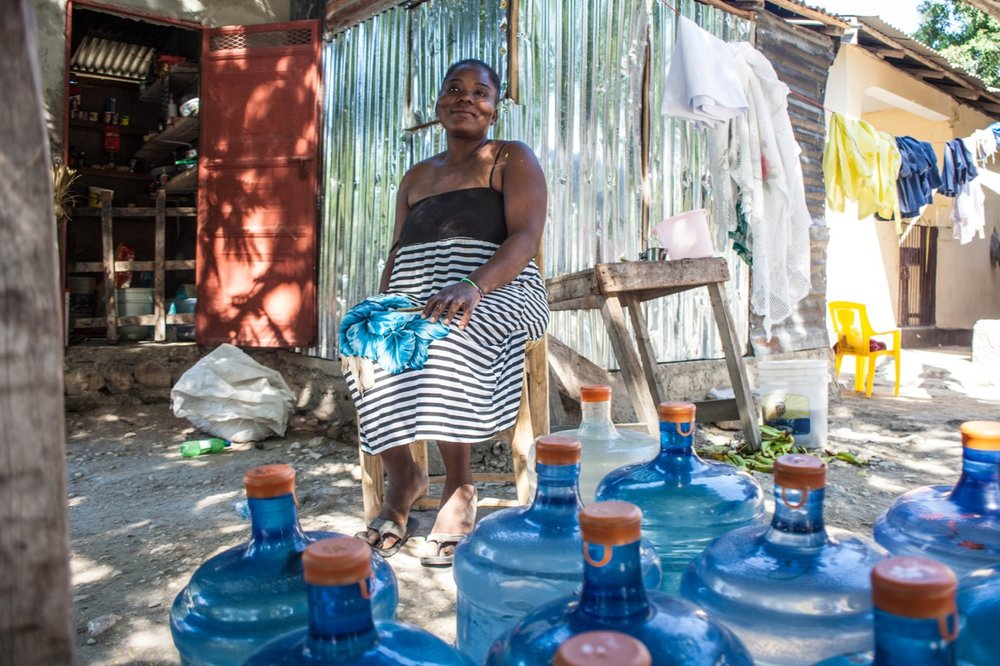 entrepreneurs earn extra income reselling ovive while making safe water available when and where it's needed: close to home. Photo Credit: Keziah Jean