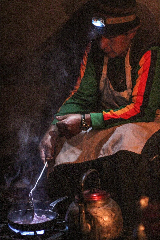 Julio preparing a steak dinner.
