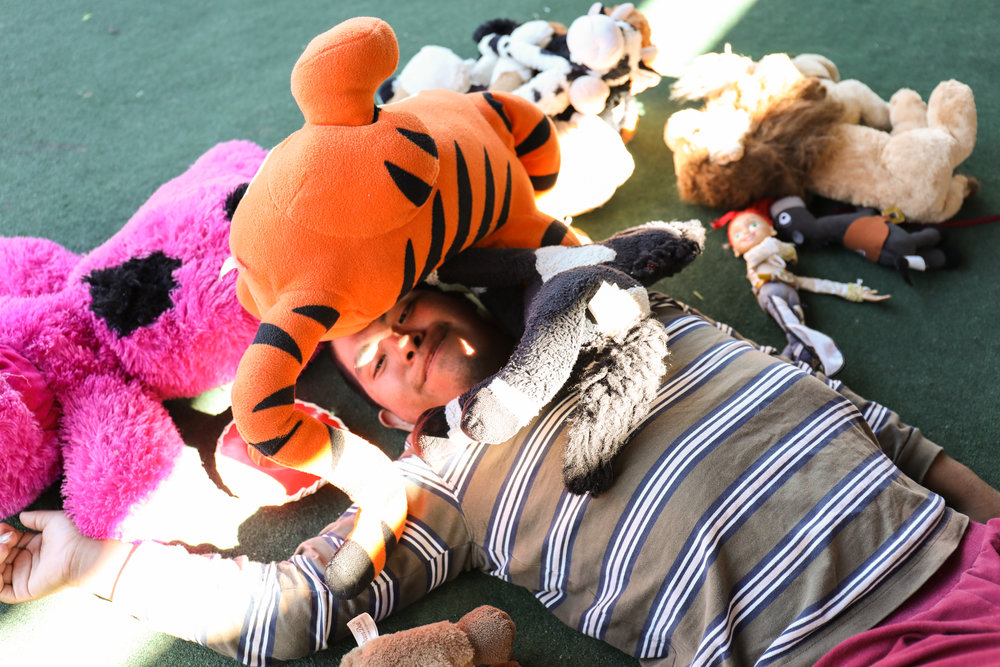 He also loves stuffed animals. El tigre being his favorito!