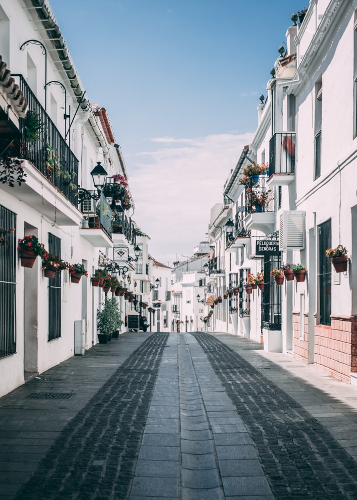Adorable cobblestone street perfect for wedding portraits in Spain