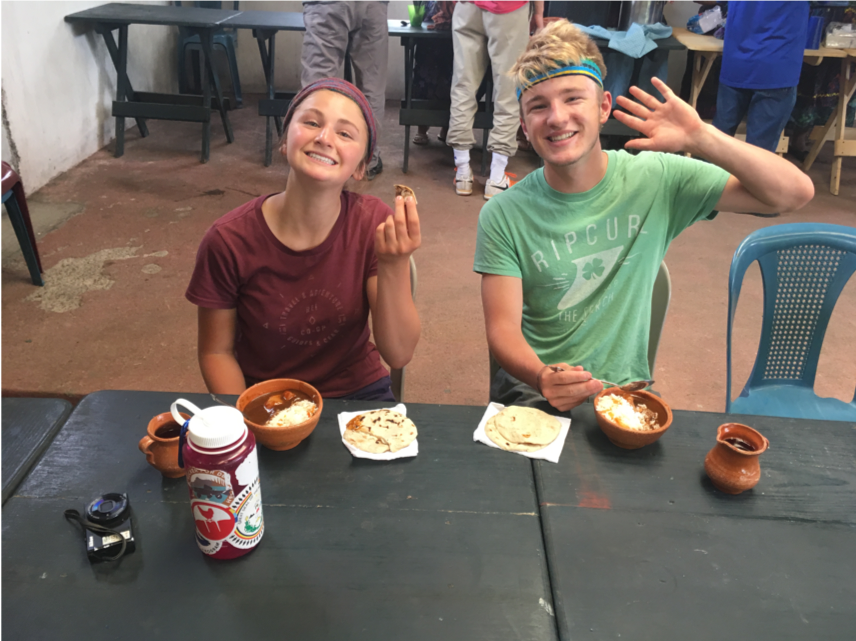 Students tasting a traditional Guatemalan dish called Pepian.