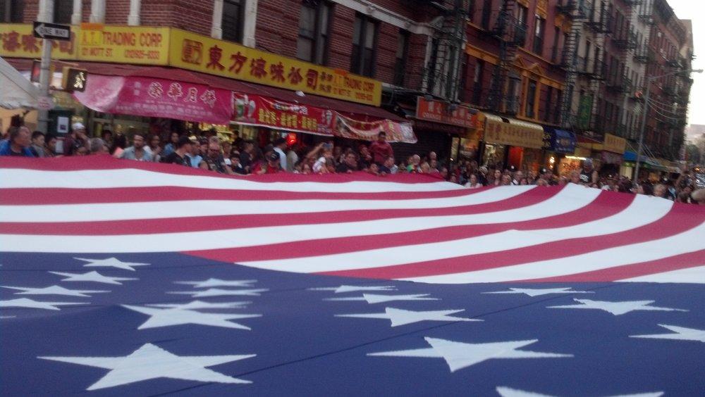 Ground Zero Volunteers & Family Unite Annually @ The September Tribute 2017 - Ground Zero Volunteers Flag, Chinatown, NYC. Photo: Erick Robertson