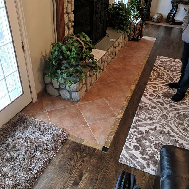 Check out the before and after if this unique installation we just finished in #winecountry … Our customers wanted to keep the original hardwood inset, but swap out the tile for something a little more current and complementary to the wood. We pulled out the tile bordering the whole room, and replaced it with some Fantasy Brown Satin by @arizonatile. The hearth got a facelift too! . . . #InteriorDesign #Flooring #Vinyl #Laminate #Carpets #Wood #LVP #Rugs #Tile #Stone #Ceramic #Grout #Hardwood #HomeDecor #contractor #NewFloors #Remodel #FlipHouse #realtor #realestate #shawcarpets #kitchen #livingroom #newhome #wehavekeys #movingin