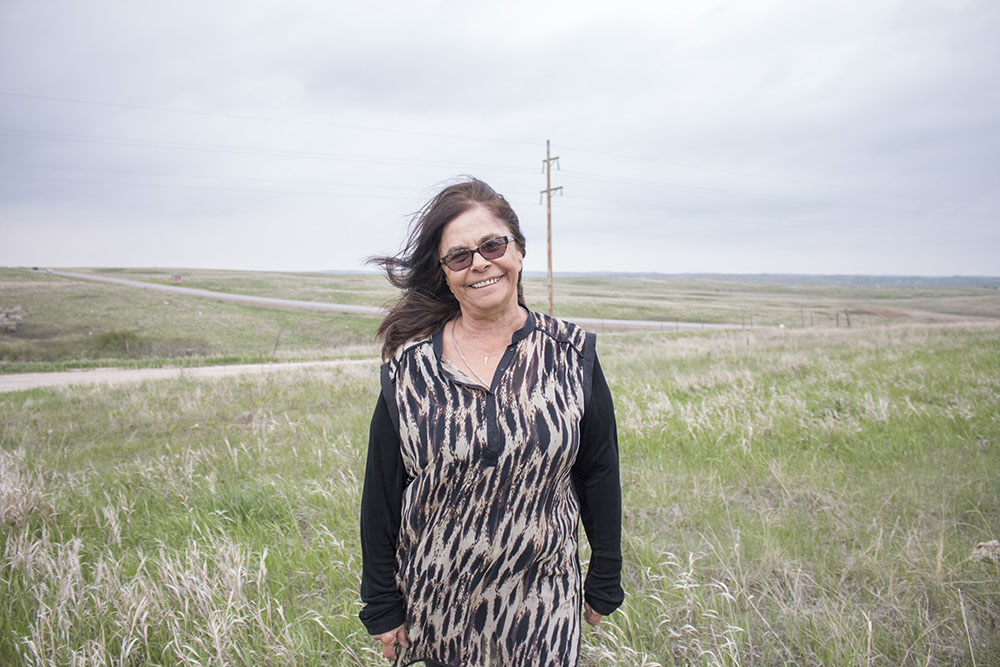 Karlene Hunter stands outside of her office in Kyle, South Dakota on the Pine Ridge Reservation.