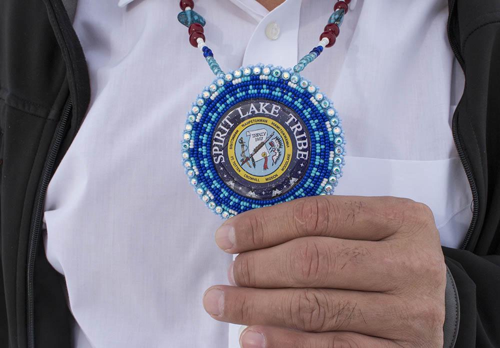 Doug Yankton holds an emblem that a Spirit Lake Tribal member gave him.