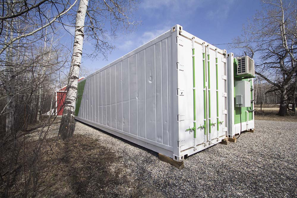 The forty-foot shipping containers where Brittany grows produce.