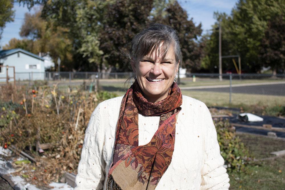 Ellen stands in the La Grande Community Garden.