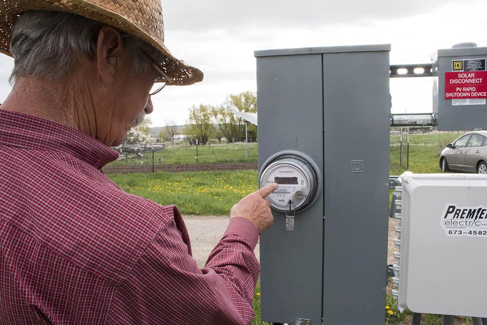 Tom checks the levels of his solar panels.
