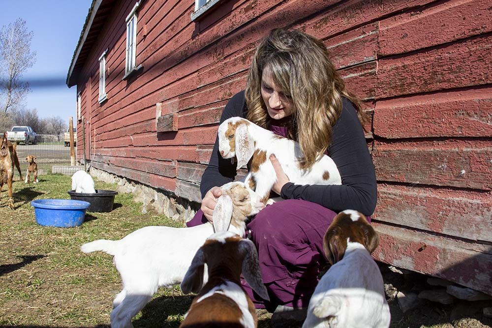 Sara with goats at her home in Molt, Montana.