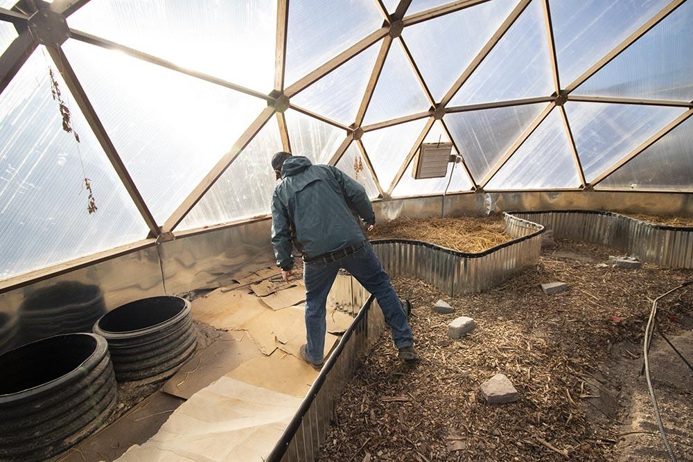 Mike Prate inside the Keya Wakpala Garden's greenhouse.