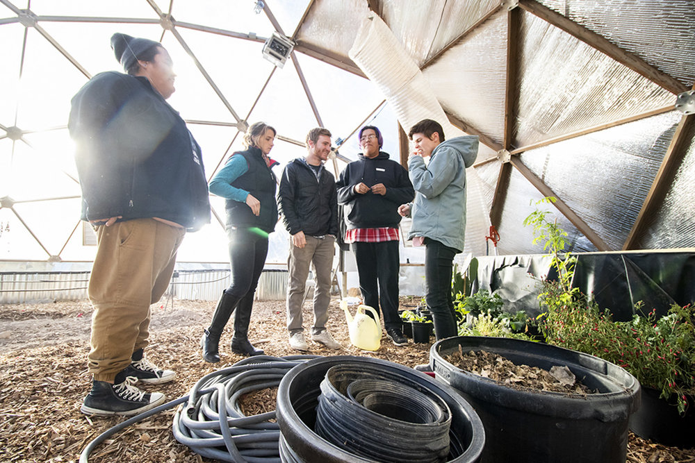 The Sicangu Food Sovereignty Initiative Staff, Matt Wilson, Rachel Kent, Aaron Mandell, Edwin Her Many Horses, and Hollis Vanderlinden in the greenhouse at the Keya Wakpala Garden, in South Central South Dakota, on the Rosebud Reservation.