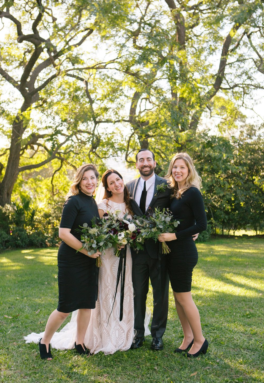 Lorie & Adam with bridesmaids- Photo by Rainbeau Tharp
