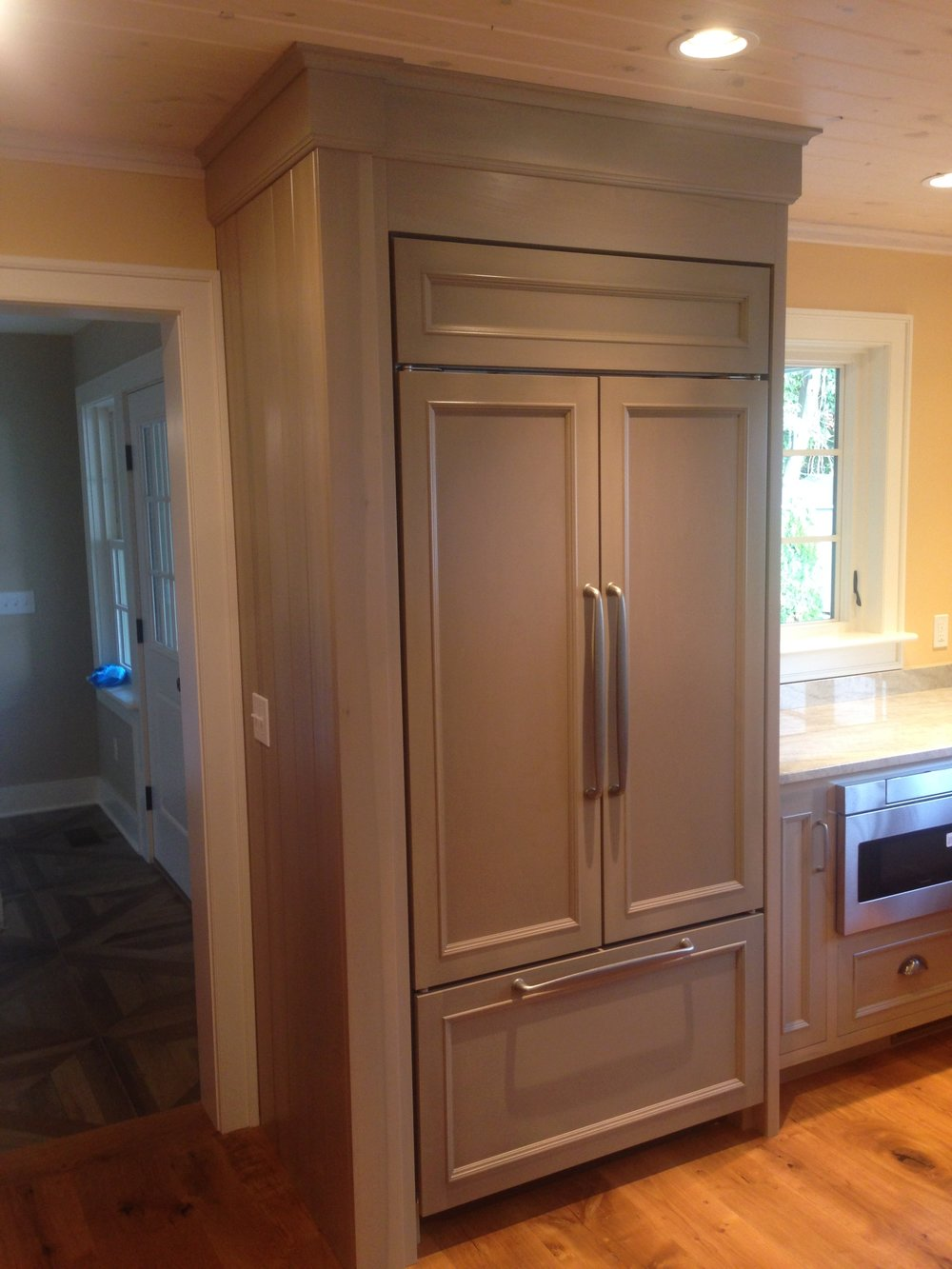 A Cottage Kitchen in Semi-Transparent Sage Lacquer, Quartzite Countertops, and Whitewashed Uppers 5.jpg