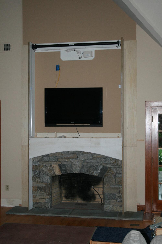 Fireplace Surround with Motorized Panel Lift 5.jpg