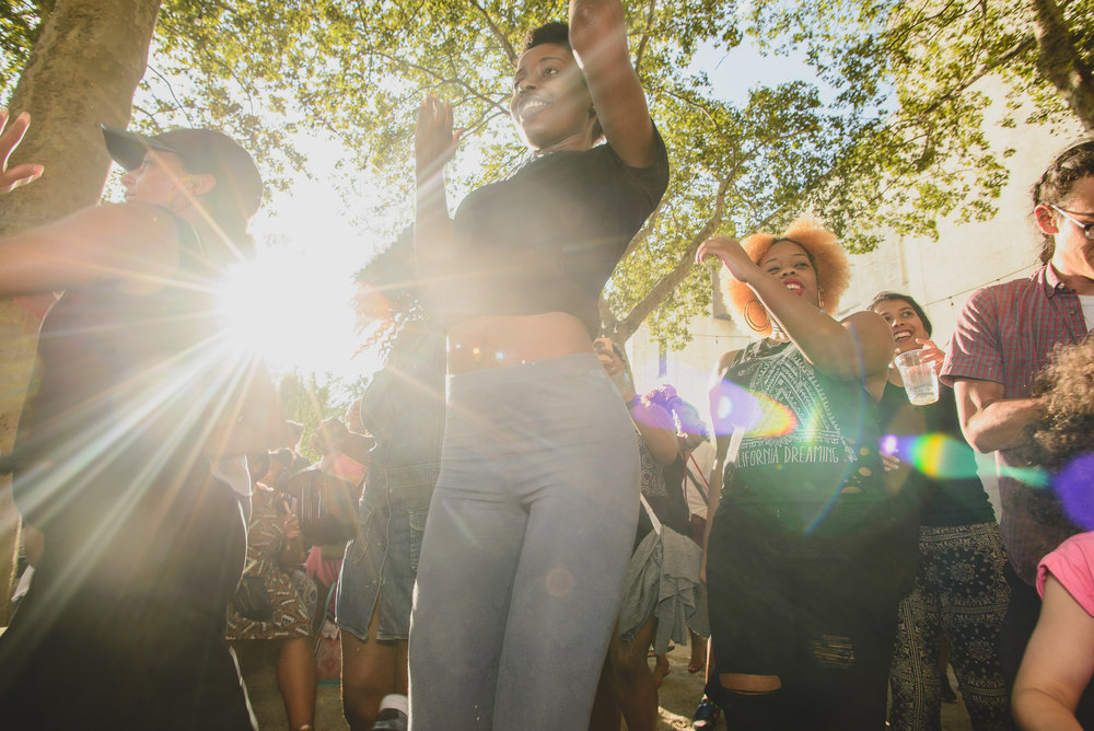 Crowd dancing at Brooklyn Musuem's CaribBEING Target First Saturday