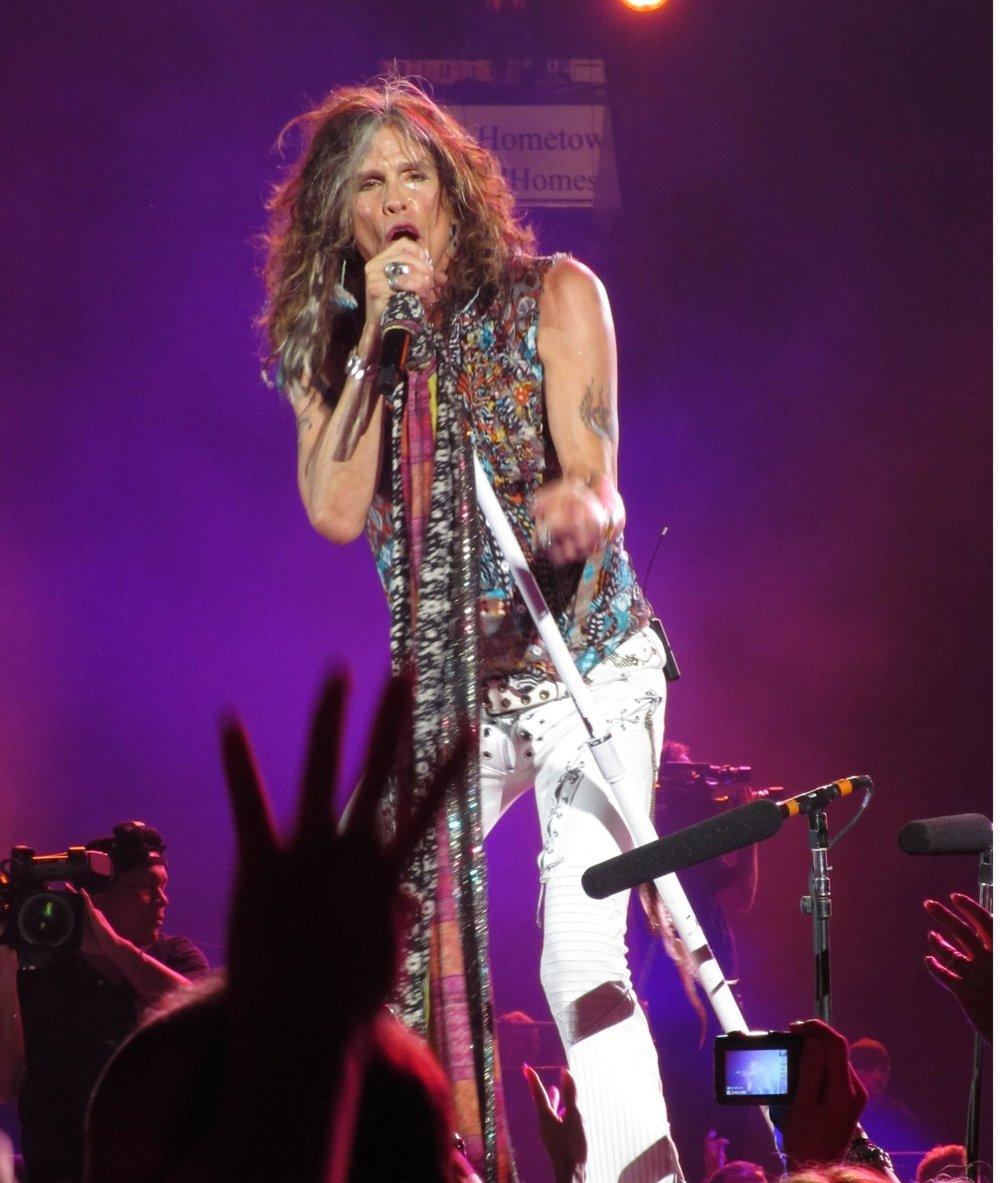 Steven Tyler, lead singer of Aerosmith, from https://upload.wikimedia.org/wikipedia/commons/f/f5/TylerNassauColliseum.jpg