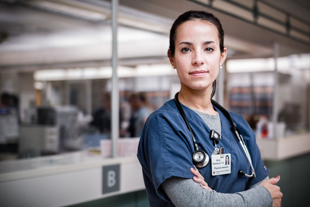 Confident-Female-Nurse-Portrait-at-Nursing-Station-X2.jpg