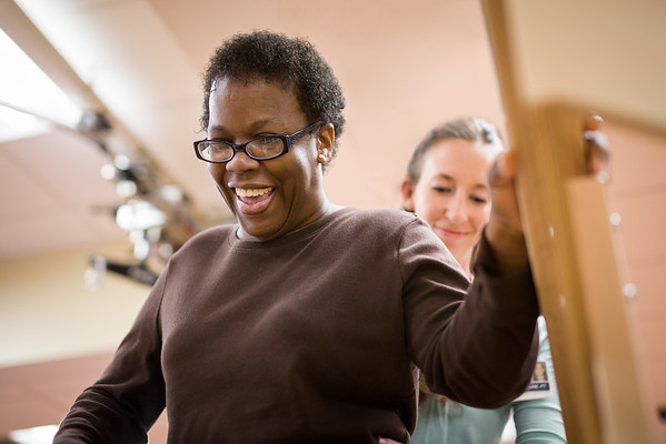 African-American-Female-Patient-Smiling-During-Physical-Therapy-M.jpg