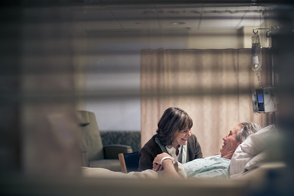 Couple-Laughing-Together-in-Husbands-Hospital-Room-M.jpg