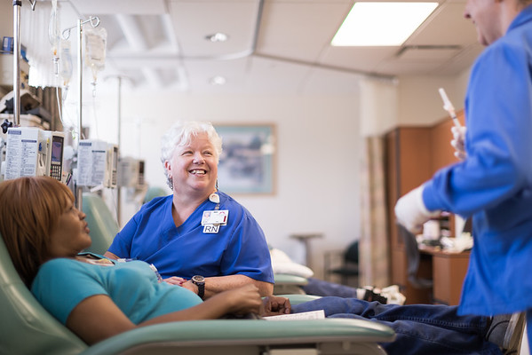Experienced-Female-Nurses-Enjoying-Time-With-Chemo-Patient-M.jpg