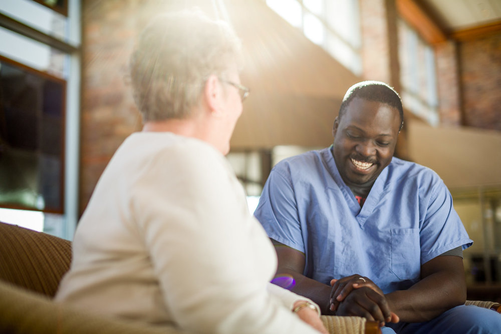 Male-Nurse-Laughing-With-Patient-in-Lobby-X2.jpg