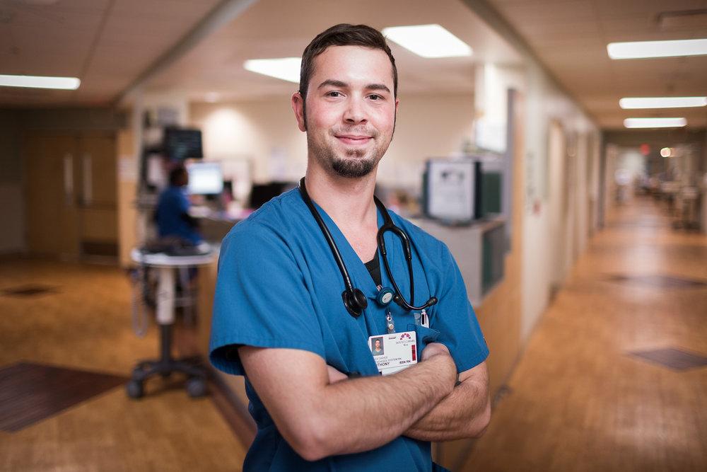 portrait-of-male-nurse-near-nurses-station-X2.jpg