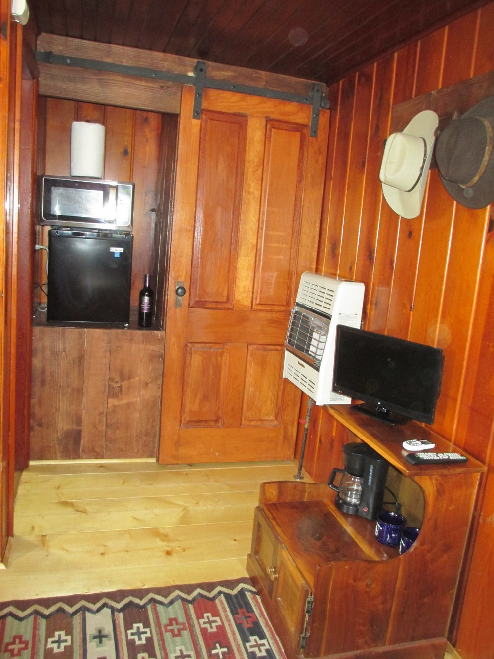 The Fire House TV, kitchenette, and closet