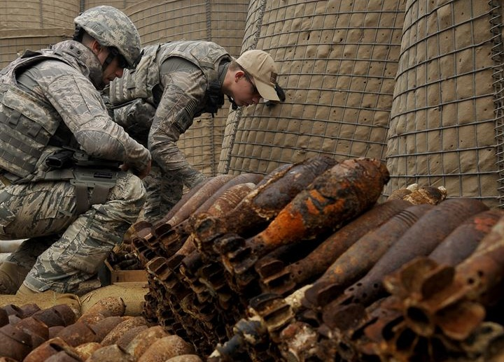 US Air Force technicians destroying a seized firearms and munitions stockpile. Image from US Air Force Central Command.