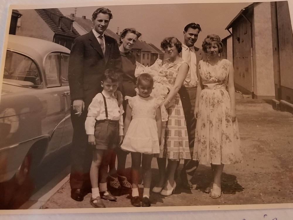 In Mannheim 1959: my great-grandmother Irmgard with her son (left) and his two children, my grandmother Marlies holding my mother Dagmar beside her husband Werner, and Irmgard's daughter Ute (right).