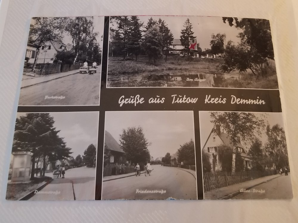 A postcard from Tutow, where my grandmother's family came from in former Pommern, Prussia. The house with the 'x' (top) was her home.