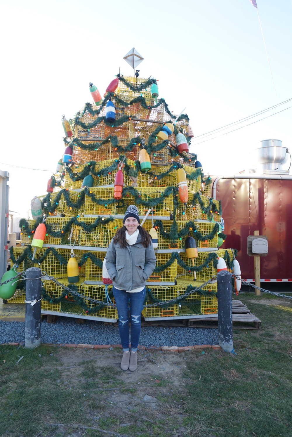 Standing in front of the lobster trap tree on Long Wharf in Newport. It's more pretty at dusk with lights on!