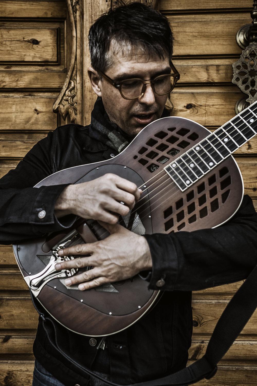 Guitarist, VocalisT, Composer -