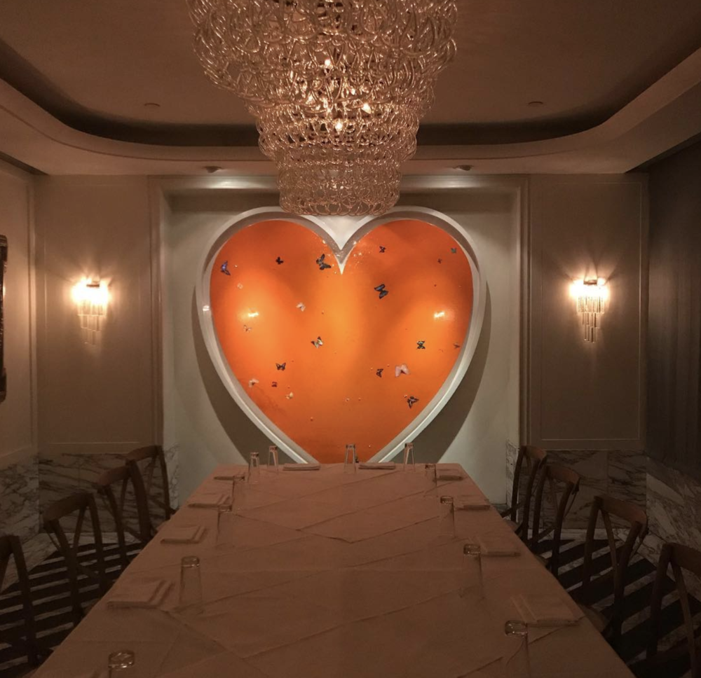 A private dining room at Cecconi's in West Hollywood, featuring a Damien Hirst!