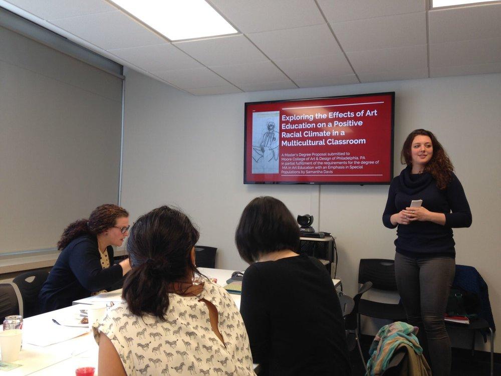 Moore alum Samantha Davis presenting thesis work.